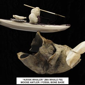 Kayak Whaler with tail Carving Moose Antler on Fossil bone base